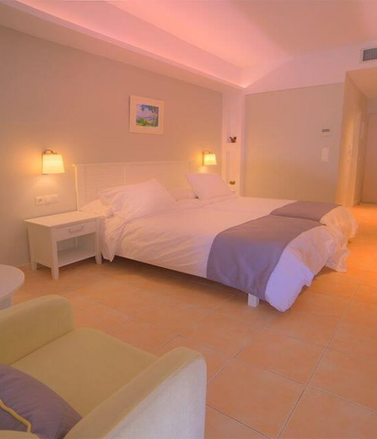 Elea Beach Gallery Image showing a room with 2 single beds from opposite view