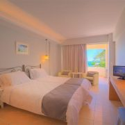 Elea Beach Gallery Image showing a room with 2 single beds showing the balcony